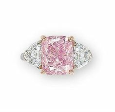 """""""The Vivid Pink"""", an exquisite coloured diamond and diamond ring, by Graff. photo Image 2009 Christie's Ltd    Set with a cushion-shaped fancy vivid pink diamond weighing 5.00 carats, flanked on either side by a shield-shaped diamond, mounted in platinum and 18k rose gold,"""