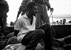 (The last picture of Patrice Lumumba) Patrice Lumumba was executed by a firing squad. His body, which was buried on the spot, was later dug up and dissolved in acid. The bones were ground up and scattered to the winds to make sure there was nothing left of him. The colonel who deposed Lumumba, Joseph Mobutu – later Mobutu Sese Seko – would rule the country despotically until 1997. – Photo: Horst Faas, AP .. For me   the background in this picture is more than a hint... Its big fun for some.