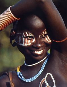 Africa. Surma girl from Ethiopia with painted eye mask. African Ceremonies Calendar by Carol Beckwith and Angela Fisher. New York: Universe Publishing 2009.