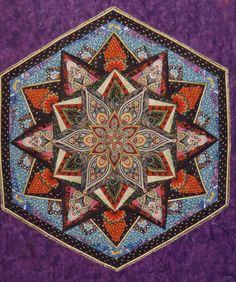 A close-up of the kaleidoscope quilt's center.