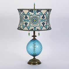 Ingrid by Susan Kinzig and Caryn Kinzig (Mixed-Media Table Lamp) Mixed-Media Table Lamp - Brightly colored turquoise blown glass, round shade covered with embroidered silk, beaded pulls and finial, double bulb socket. Lamp Light, Light Up, Style Deco, Brass Lamp, Pendant Lamps, Pendant Lights, Outdoor Light Fixtures, Lamp Shades, Glass Table
