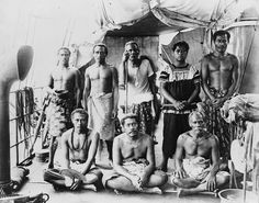 File:Lauaki Namulau'ulu Mamoe (standing 3rd from left with orator's staff) and other chiefs aboard German warship taking them to exile in Saipan, 1909.jpg - Iiga Pisa would have been 26 y old at the time of exile 1909 and I wonder if that the young man seated.