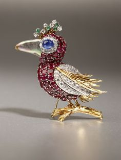 Lot# 1139 A gemset bird brooch. $2875.00