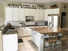 These are 10 inventive ways to decorative the space above your kitchen cabinets. kitchen decor above cabinets 10 New Ideas for Decorating Above Your Kitchen Cabinets Top Of Cabinets, Above Cabinets, Open Cabinets, Dark Cabinets, Decorating Above Kitchen Cabinets, New Kitchen Cabinets, Rustic Cabinets, Cabinet Top Decorating, Kitchen Walls