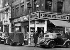"The Continental Fruit Stores on the corner of Frith Street and Old Compton Street. The Continental Fruit Stores was the scene of the infamous fight between local tough guys Albert Dimes and Jack ""Spot"" Comer in Street Pictures, London Pictures, London Photos, Old Pictures, Old Photos, Vintage London, Old London, Vintage Photographs, Vintage Photos"