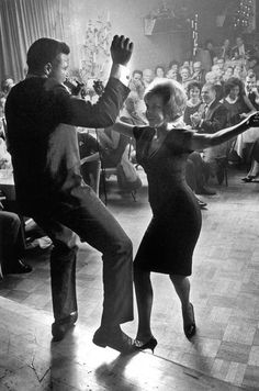 """Chubby Checker and the twist, 1961 - note that this is an integrated setting. To some Americans, this demonstrated the dangers of """"black"""" music and racial mixing - dancing would inevitably   Ear to interracial sex."""
