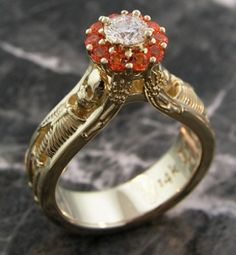 """This skeleton engagement ring contains a 0.33 carat diamond center and is adorned with a frame of imperial topaz around it. One of a kind and crafted in 14k yellow gold. """"Till death do us part"""" by Images Jewelers"""