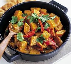 Heat korma paste and toss with sweet potatoes, peeled and cut into large chunks.  Pour in coconut milk and water then cook for about 15 mins or until the sweet potato is tender. Tip in pineapple chunks simmer for 2 mins, then season. Scatter with coriander and serve with naan bread.
