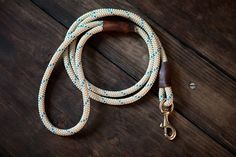 Handmade custom leash utilizing extremely durable braided cord. Features a hand loop and brass or nickel quick clasp for easy usage. Hand cut and