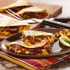 Cantina Steak Quesadillas with Skillet-Charred Corn Salsa | Stuck in a dinnertime rut? Serve quesadillas filled with marinated steak, shredded cheese and a colorful salsa of lightly charred corn, bell pepper and onions.
