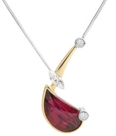A unique ruby red rubelite tourmaline pendant with diamonds, set in 18ct yellow and white gold.