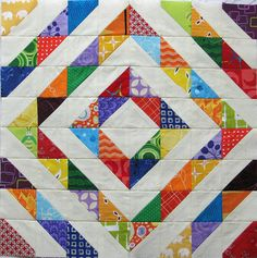 Scrappy triangles by KCQuilts, via Flickr