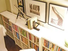 This is one brilliant #ikeahack using low Billy bookcases. Plus, it leaves plenty of space above it to create a gallery of photos and frames.