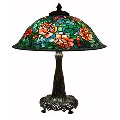 """Tiffany Studios Rose Table Lamp  United States  circa 1906  Tiffany Studios leaded glass and bronze table lamp comprising a """"rose"""" design shade on a bronze reticulated telescopic library standard table base in a dark brown patina. The lamp has an original bronze reticulated heat cap in matching finish. Both the shade and the base are signed."""