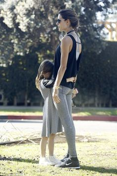 Sweet: Anjaclung to her mom, wrapping her little arms around Alessandra's waist...