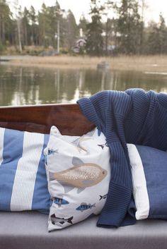 Ahti Cushion Cover   Pentik   Designed by Lasse Kovanen, this fisherman's favourite series brings to mind hazy summer mornings, fishing trips and loon cries both in the cottage and at home. This series appeals both to bigger and smaller fishermen.
