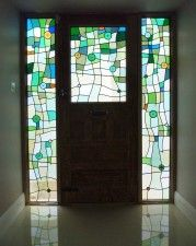 3 modern stained glass panels with roundels and lenses. North London Stained glass.