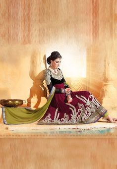 Burgundy faux georgette semi stitch anarkali kameez is designed with resham, zari, stone, bead, gota patti , stone and patch border. Contrasting mehendi green poly shantoon churidar and mehendi green faux chiffon dupatta comes along with this. (Slight variation in color and patch border is possible). data-pin-do=