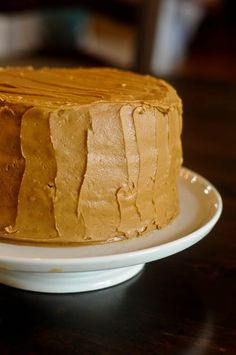 Southern Caramel Cake is one of those desserts that is a true labor of love. So rich and decadant, it's a cake that surely takes any special occasion to a whole new level and is by far one of my family's favorite cakes. We celebrated two birthdays in my family this past weekend - Mama's and my