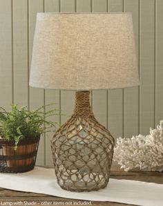 Sea Bottle Jug Lamp with Shade, by Park Designs. This nautical inspired sea bottle jug lamp features a jute fishing net overlay. Measures x 9 inches. Use with up to a 100 watt bulb (not included). Wine Bottle Art, Glass Bottle Crafts, Diy Bottle Lamp, Beach House Decor, Home Decor, Macrame Design, Diy Home Crafts, Kids Crafts, Diy Wall Decor