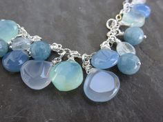 "chalcedony cluster necklace, including aquamarine and angelite; angelite; one of the ""stones of awareness""  It represents peace and brotherhood."