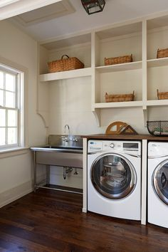 Metal sink, just like in restaurants, easy to keep clean in the laundry room. Baskets to hold anything you can think off.