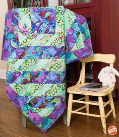 "When it comes to spectacular color, Kaffe Fassett never fails to deliver! The Fragmented Triangles Kit includes a pattern and gorgeous Kaffe Fassett fabric, so you can sew a stunning 47"" x 47"" quilt top."