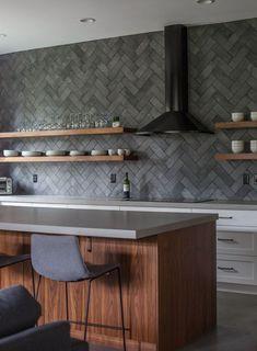 Stylish Ways To Use The Herringbone Tile Pattern In Modern Interior Design Dark grey kitchen herringbone pattern for backsplash Dark Gray Backsplash, Grey Kitchen Tiles, Dark Grey Kitchen, Kitchen Decor, Kitchen Backsplash, Backsplash Ideas, Gray Countertops, Backsplash Design, Purple Kitchen