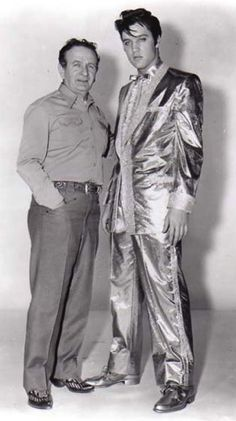 The Colonel decided that his golden boy needed a golden suit, and so he commissioned Nudie (at left with Elvis) to fashion a gold-leaf tuxedo for Elvis to wear on stage during his personal appearances in 1957.