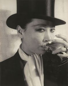 Anna May Wong in tuxedo & top hat, 1920s