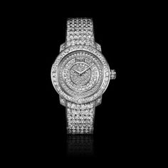 #Limelight round-shaped #watch in white gold #diamond