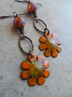 Beautiful enameled copper flower charms, expertly handcrafted by an etsy artisan, are perfectly paired together with artisan-made lampwork beads, as well as handcrafted copper oval rings. Wire wrapped in solid oxidized copper wire and suspended from copper earwires, these earrings measure about 3 from end to end. Love