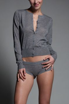 Luxe Cardigan Knit of the softest cashmere, this timeless cardigan is perfect for delicate layering. The lightweight construction makes it perfect for all seasons. Silk Lined Front Packet Extra Long Sleeves