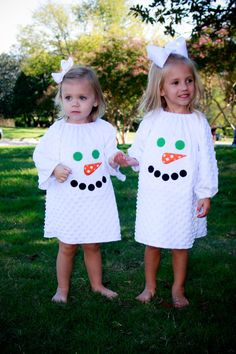 White minky dot peasant style dress with snowman face applique by Gigi Babies. $36.00, via Etsy.