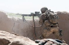 paratrooper with the 82nd Airborne Division's 1st Brigade Combat Team fires an M240B medium machine gun at insurgent forces June 15, 2012, in southern Ghazni province, Afghanistan