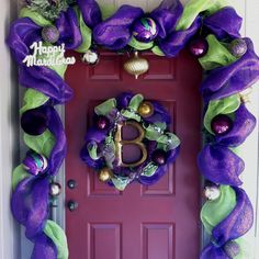 Mardi Gras door decorations using deco mesh; only time of year i think this type of door set up is called for haha Mardi Gras Carnival, Mardi Gras Party, Purple Christmas, Christmas Door, Holiday Crafts, Holiday Fun, Holiday Decor, Holiday Ideas, Mardi Gras Decorations