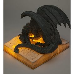 Lovers of fantasy and literature will be thrilled by this Dragon on Glowing Storybook sculpture. Either this dragon is deeply … Fantasy Dragon, Dragon Art, Dragon Garden, Dragon Statue, Magical Creatures, Fantasy Creatures, Garden Statues, Resin Crafts, Sculpture Art