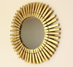Starburst mirror from clothespins and dollar store mirror. Gold Starburst Mirror, Sunburst Mirror, Sun Mirror, Wall Mirror, Dollar Store Mirror, Wooden Pegs, Diy Home Decor, Room Decor, Wall Decor