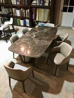 Poliform Concorde Dining Table in St Laurent marble with Grace chairs in leather - on display in the Design Studio at Beaufort Interiors, Moira.