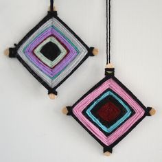 A fun holiday activity for kids, this tutorial shows the easy process of weaving Hopi Eye Christmas ornaments with scraps of yarn and two popsicle sticks.