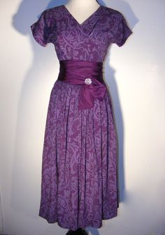 GAY GIBSON 1950's vintage dress. Purple Paisley Folk Print, Nipped Waist, Full Skirt, Sash, Rhinestone Pin