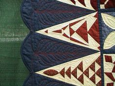 "Close up of ""Enduring Freedom"", the quilt for President Bush, showing quilting design on the triangles.  Photo at Heritage Stitches."