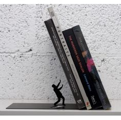BOOK ENDS FALLING BOOKS