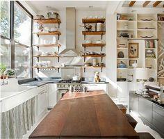 vertical kitchen shelves, long farm sink, reclaimed wood island. architectural beauty