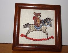 Finished Cross Stitch picture of Teddy Bear riding a Rocking Horse