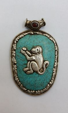Vintage Tibetan Turquoise Colored Stone Monkey Pendant Set in Sterling Silver