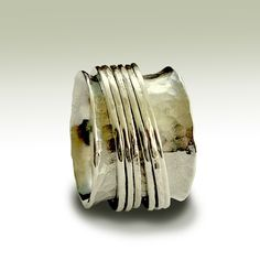 This one is awesome too. I just wish I could try them on. Don't know how they would feel on.  Wedding band - Sterling silver band with silver spinners - Falling free. $164.00, via Etsy.