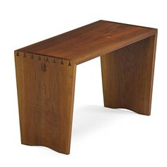 George Nakashima; Walnut and Rosewood Piano Bench, 1977.