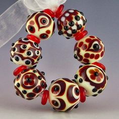 set of 7 round beads in red ivory and black layered dot designs no two alike handmade lampwork glass - Red Queen - pinned by pin4etsy.com