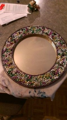 Mardi Gras mirror. Display piece, but can be replicated. Each piece will be individual. No two will be the same, Could be done in rectangle or oval mirror.